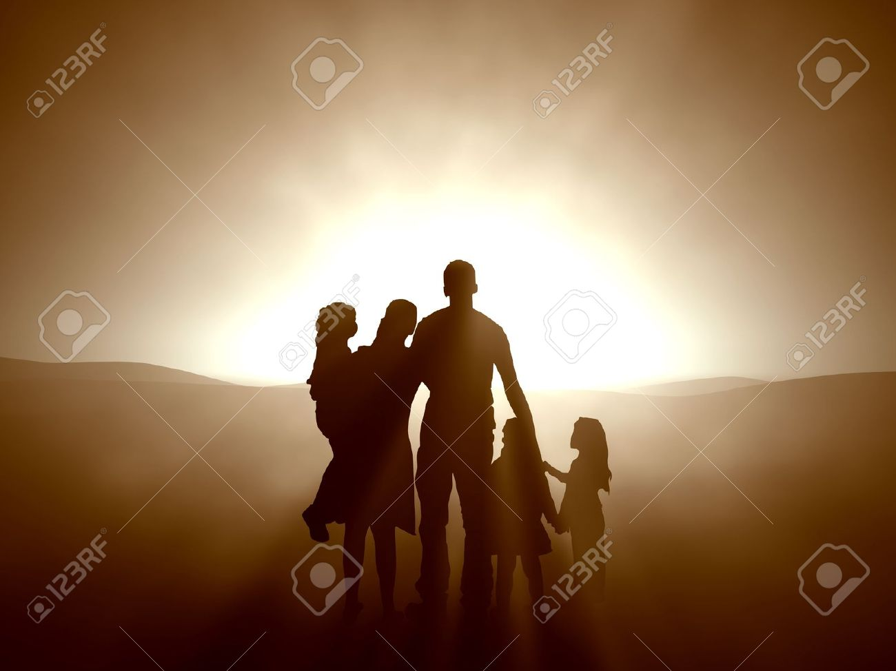 Silhouettes of a family looking towards the light. - 7150679