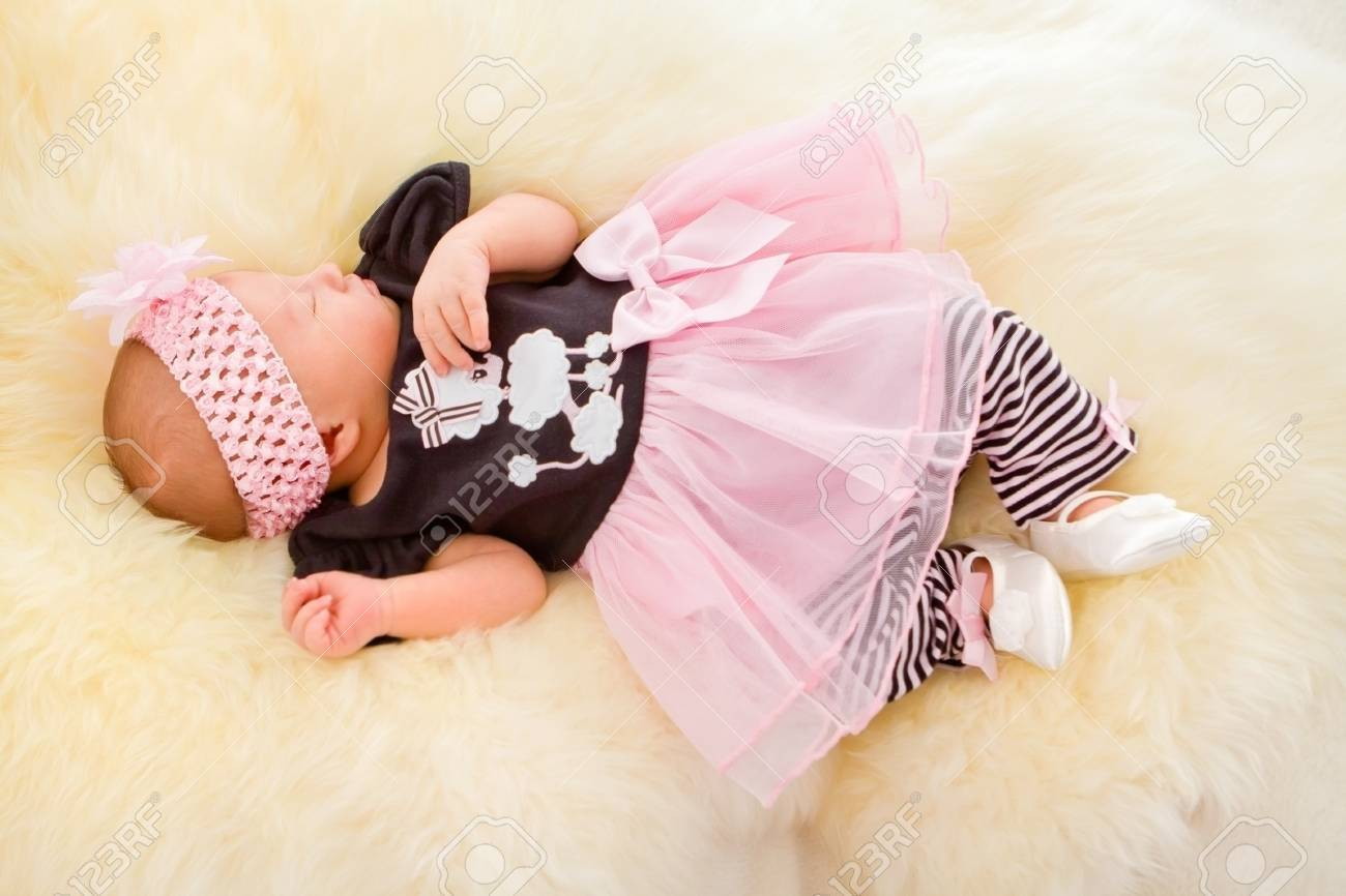 Newborn girl sleeping in cute dress Stock Photo - 16143225
