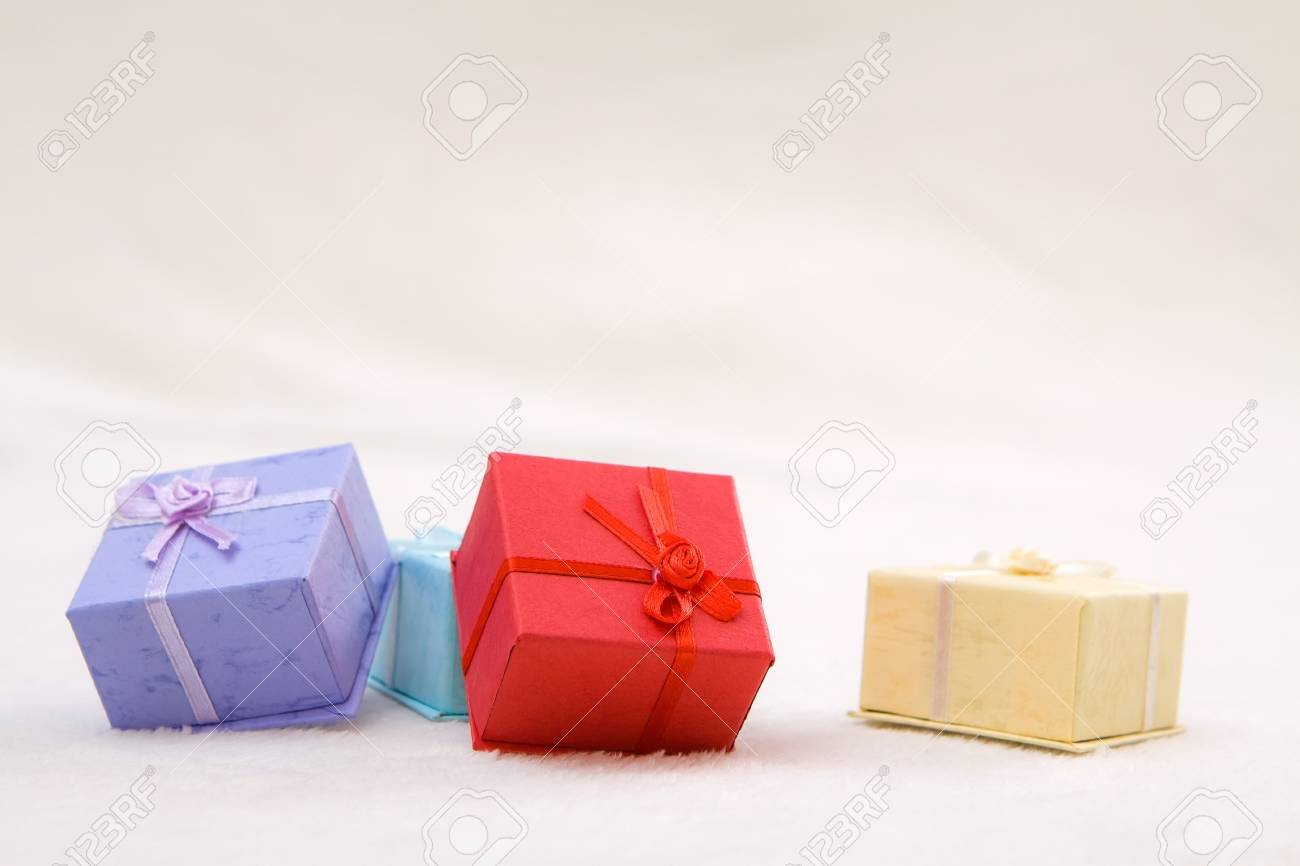 Mini colorful gift boxes on soft background Stock Photo - 16452194