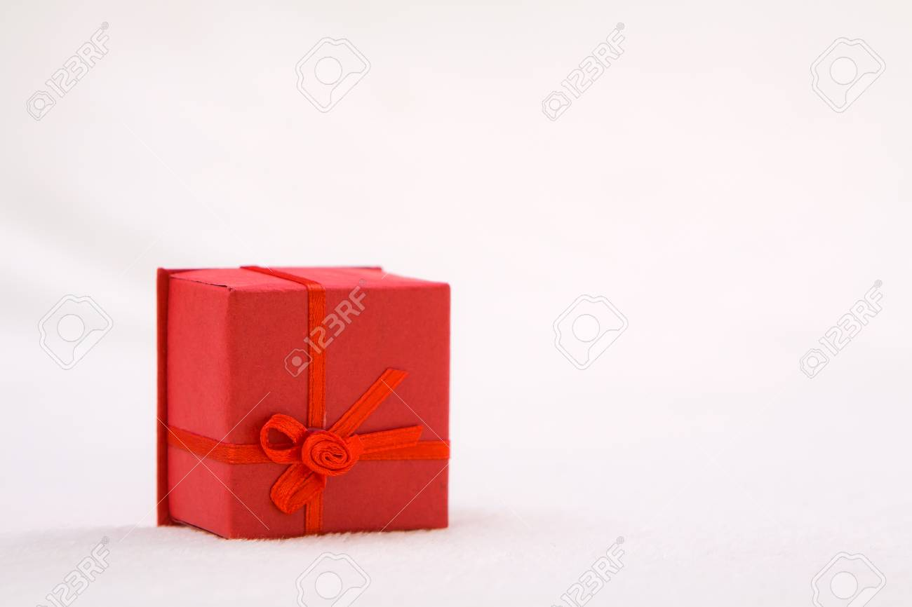 Mini red gift box on soft background Stock Photo - 16452204