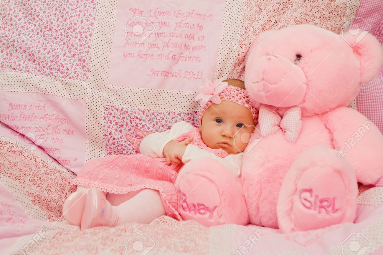 cb9ef46d2 Baby Girl On Pink Blanket With Bible Verses Stock Photo, Picture And ...