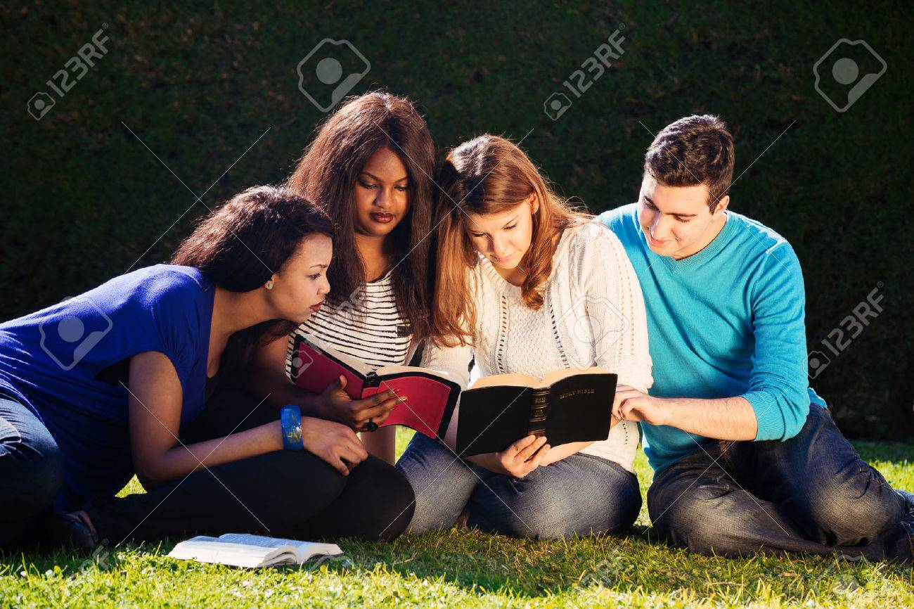 Group of Young people Studying the Bible together - 28098224
