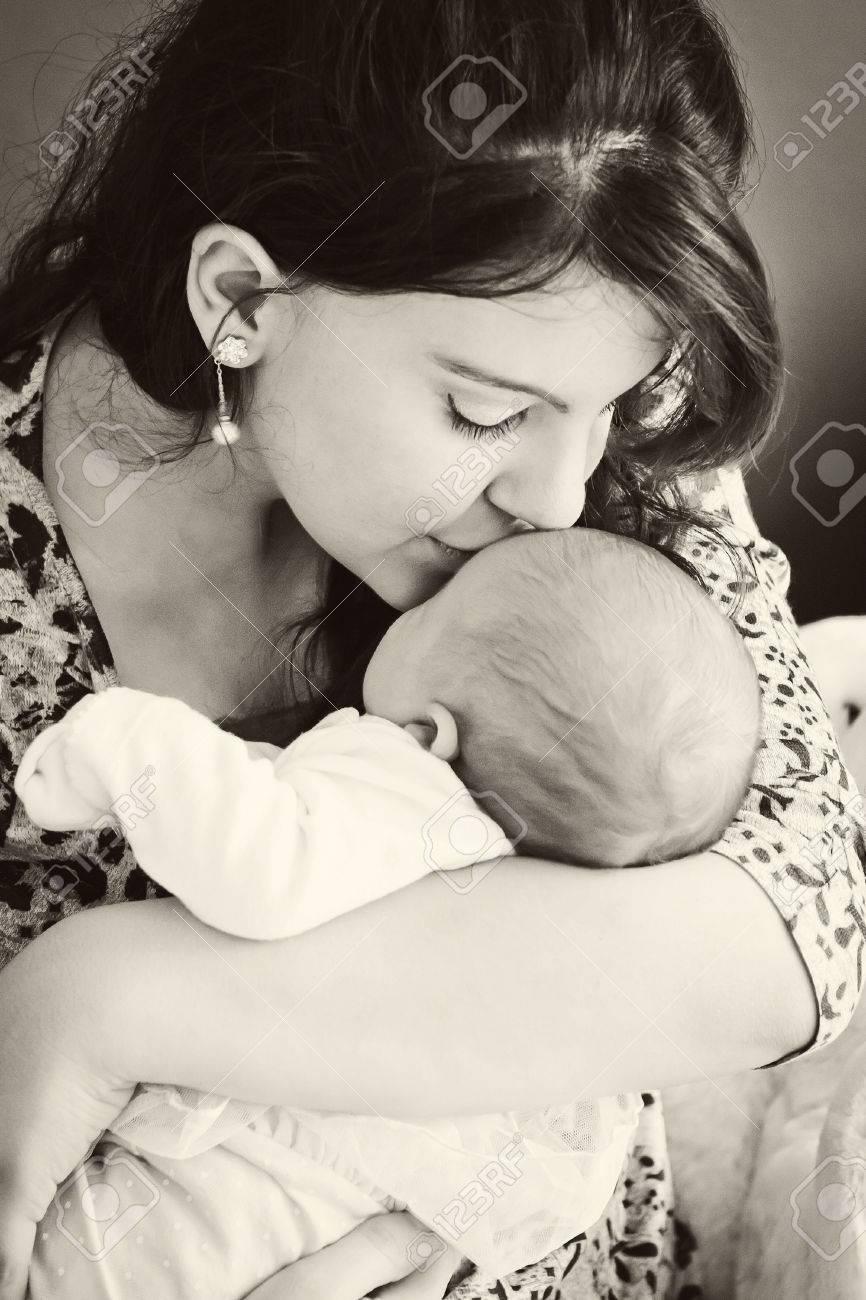 A young mother kissing her newborn baby BW - 28501348