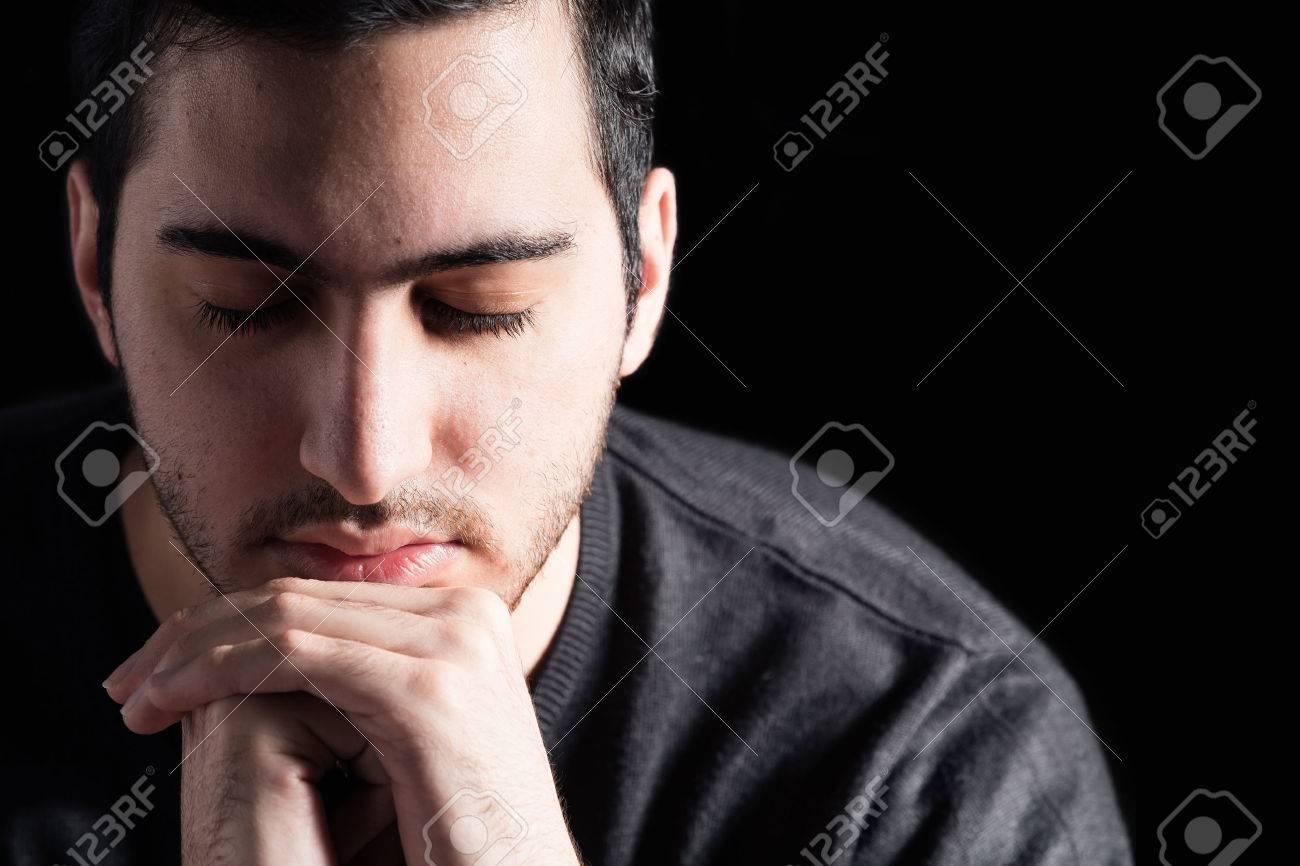 Young Man Praying - 37715954