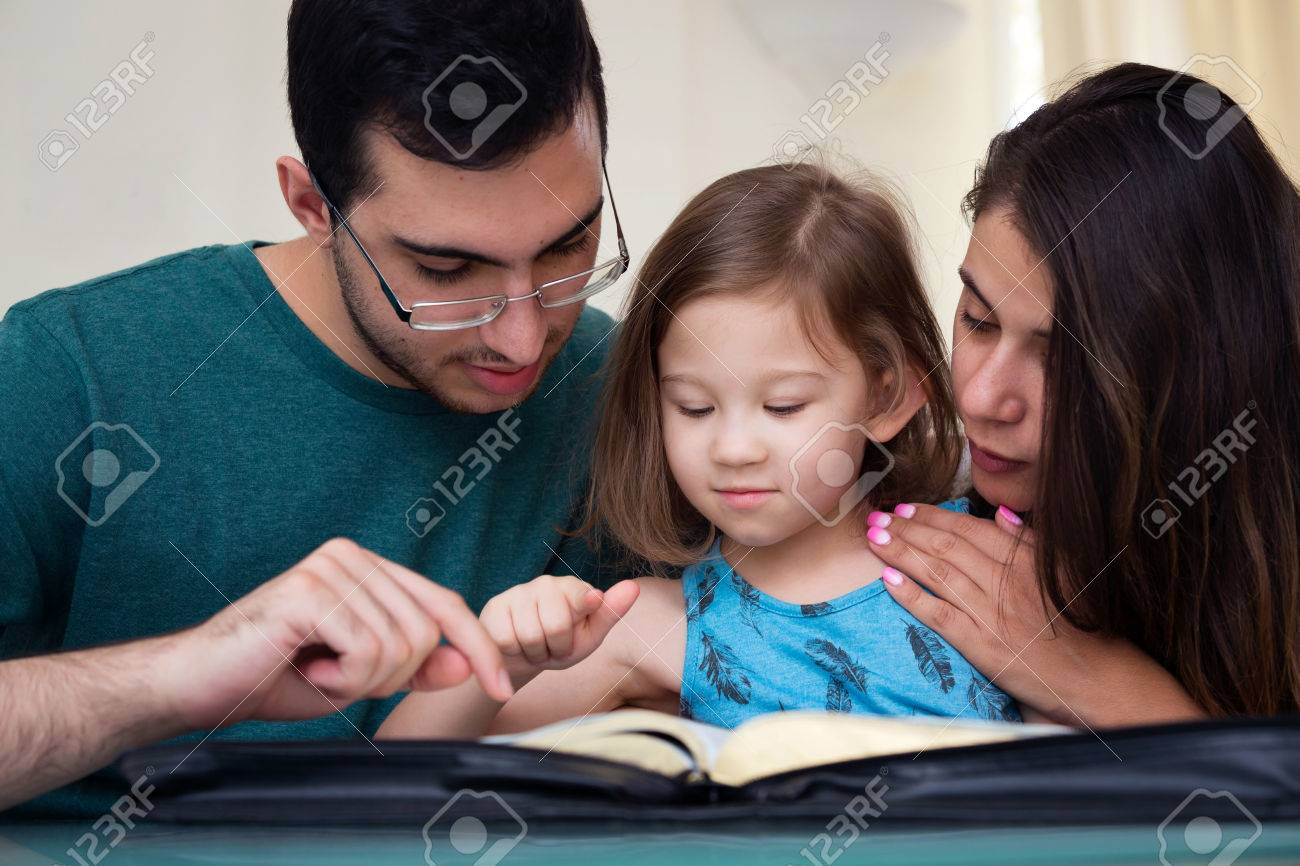 Young family studying the Word of God - 61616344