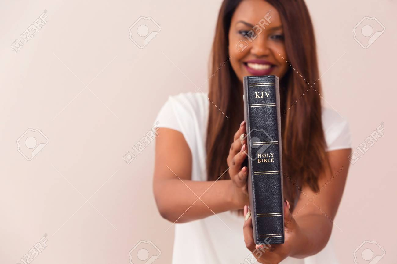 Happy Girl Proudly Showing Her King James Bible - 88330696