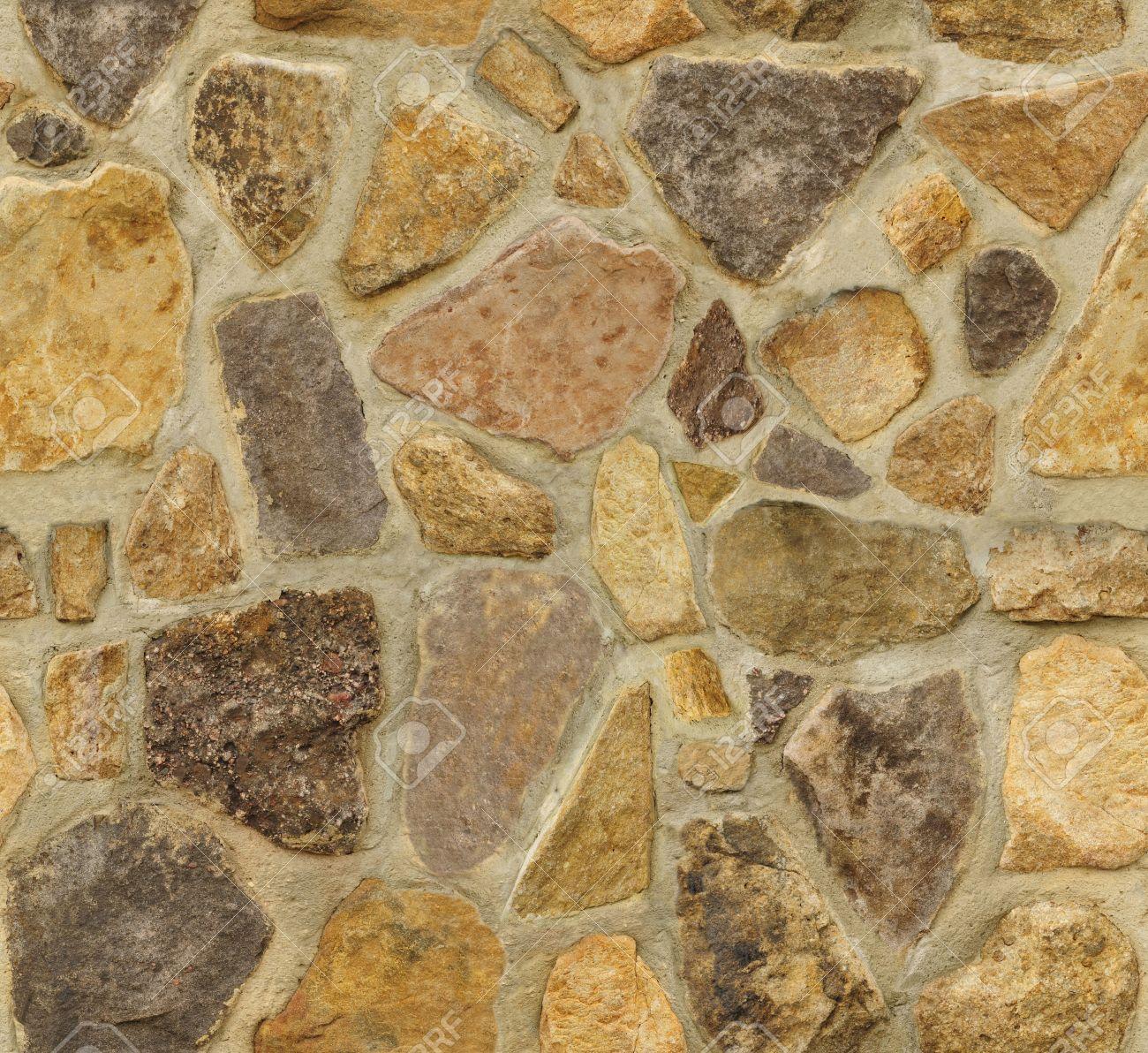 Seamless masonry wall with irregular shaped stones. The texture repeats seamlessly both vertically and horizontally. - 7059991