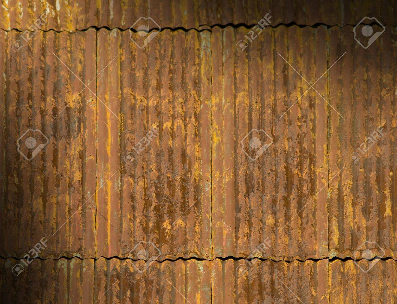 Corrugated Metal Panels For Sale - Corroded and rusty corrugated metal roof panels lit diagonally stock photo 10311154