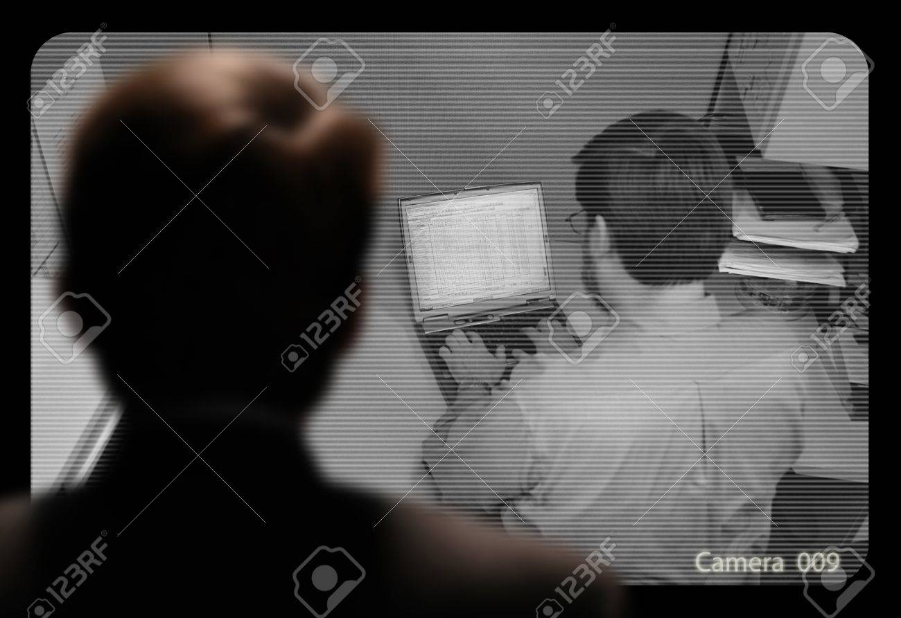 Man observing an employee work via a closed-circuit video monitor Stock Photo - 19882841