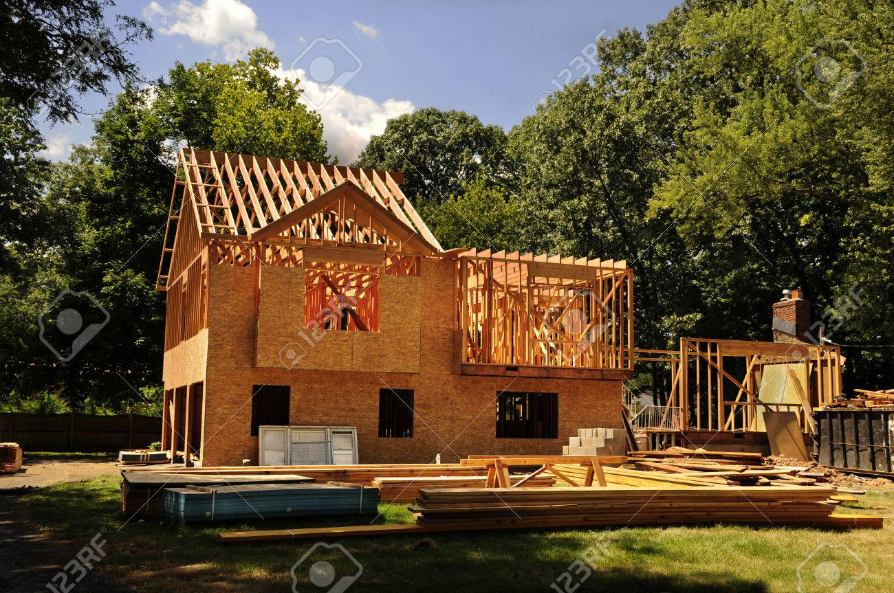 A residential home under construction mid framing and sheathing - 52940700