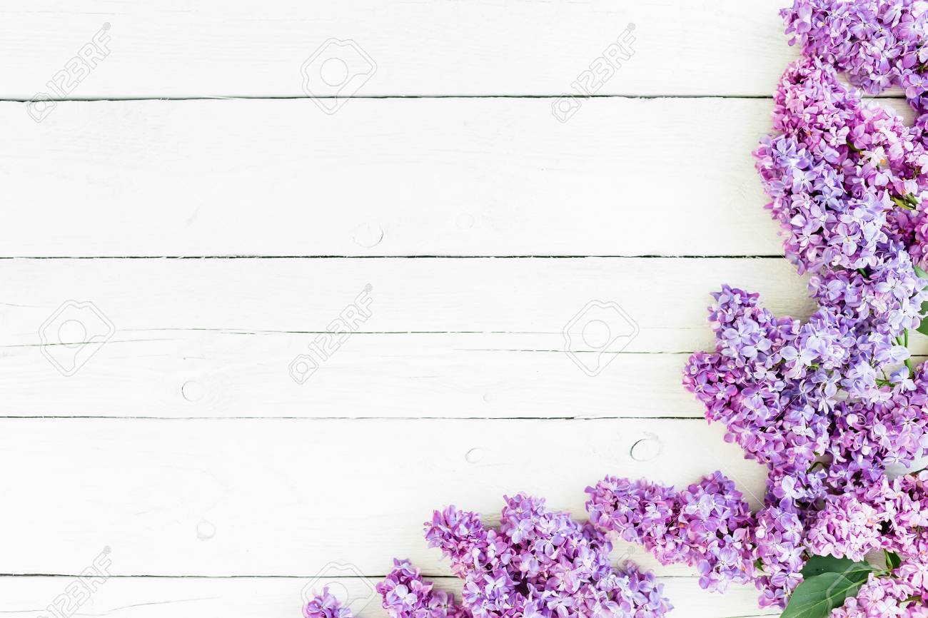 Floral Pattern Of Lilac Branches And Petals On Rustic Background Flat Lay Top View