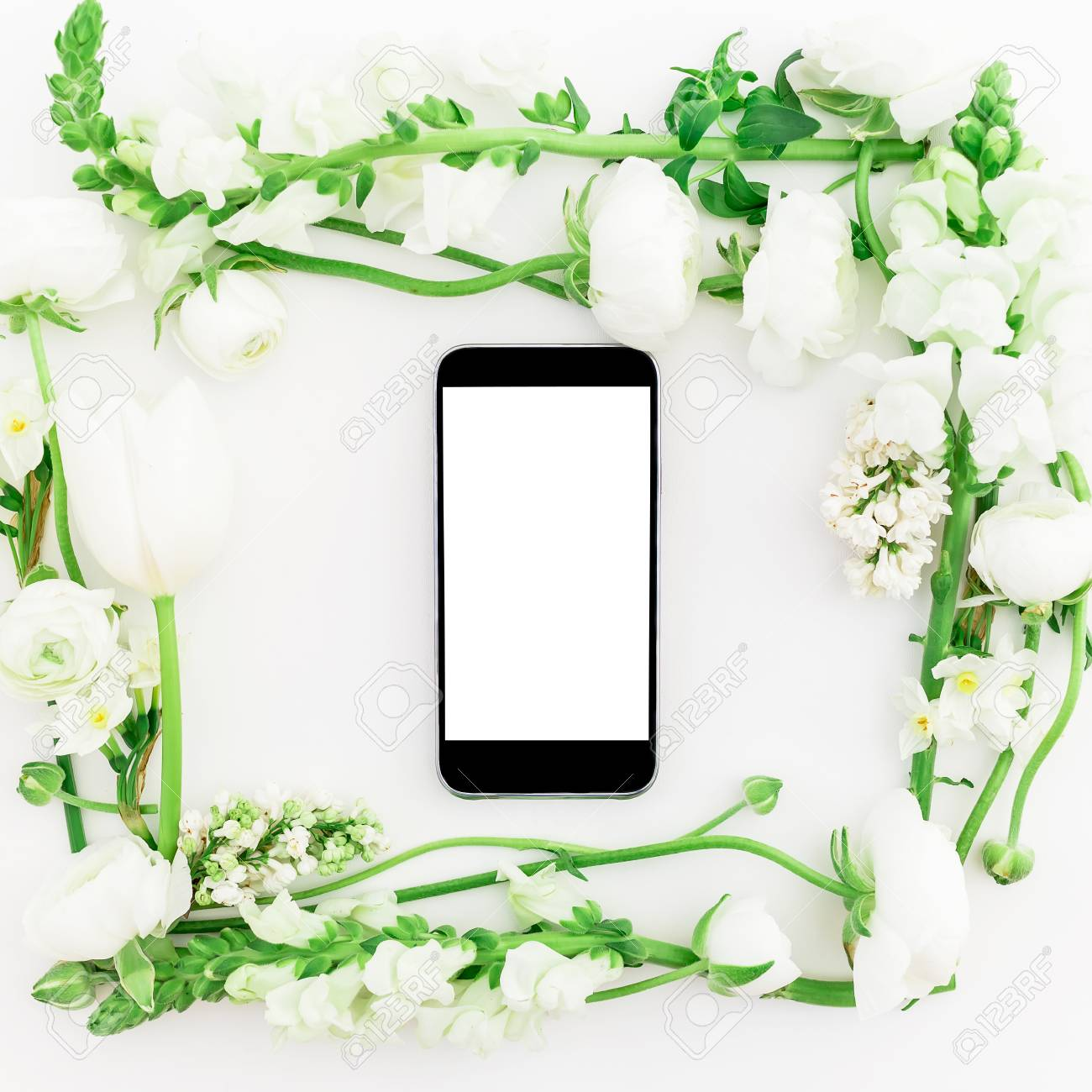 Floral Pattern Made Of White Flowers And Mobile Phone On White