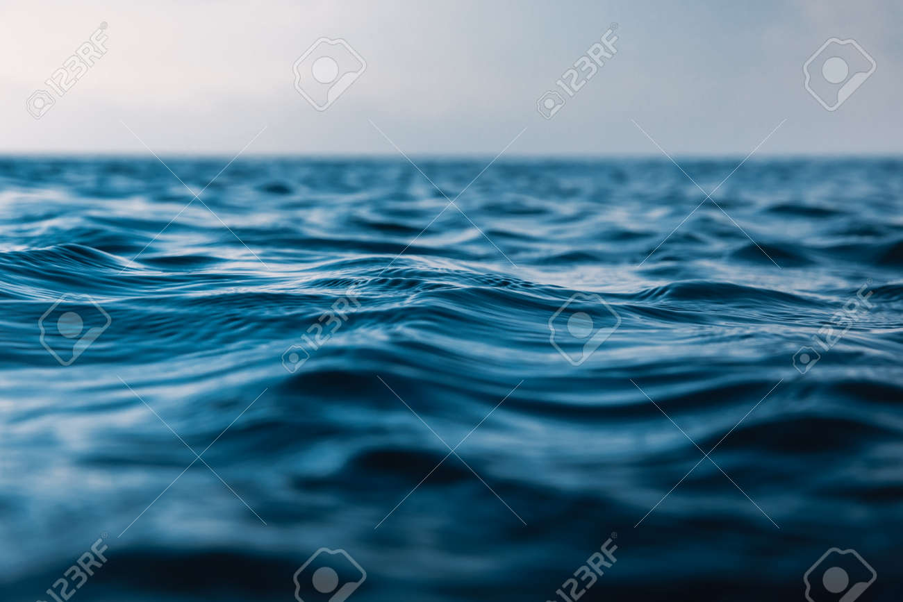 Blue waves in ocean. Water texture with bokeh - 138652617