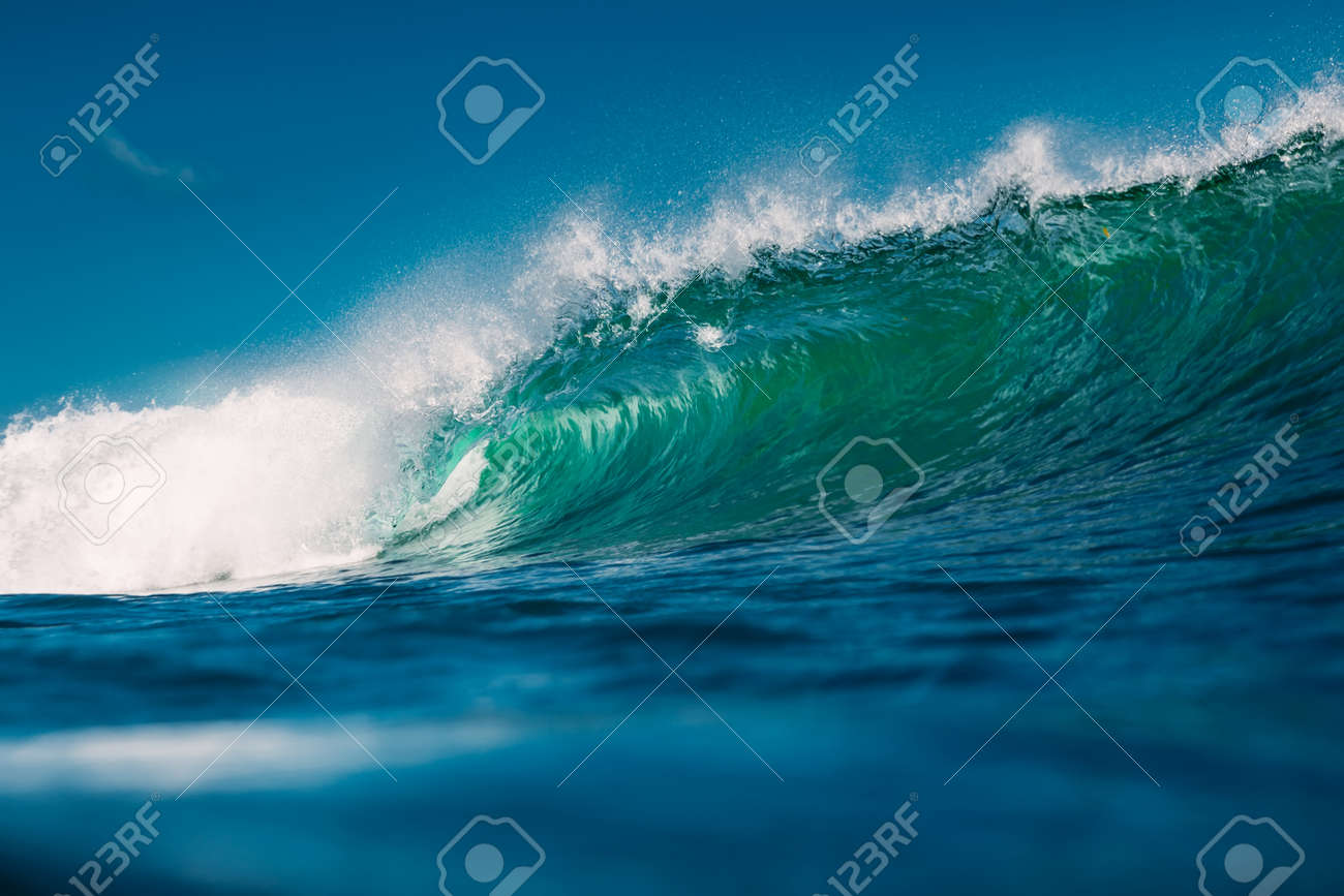 Crashing perfect blue wave. Breaking barrel wave, power of ocean - 154065702