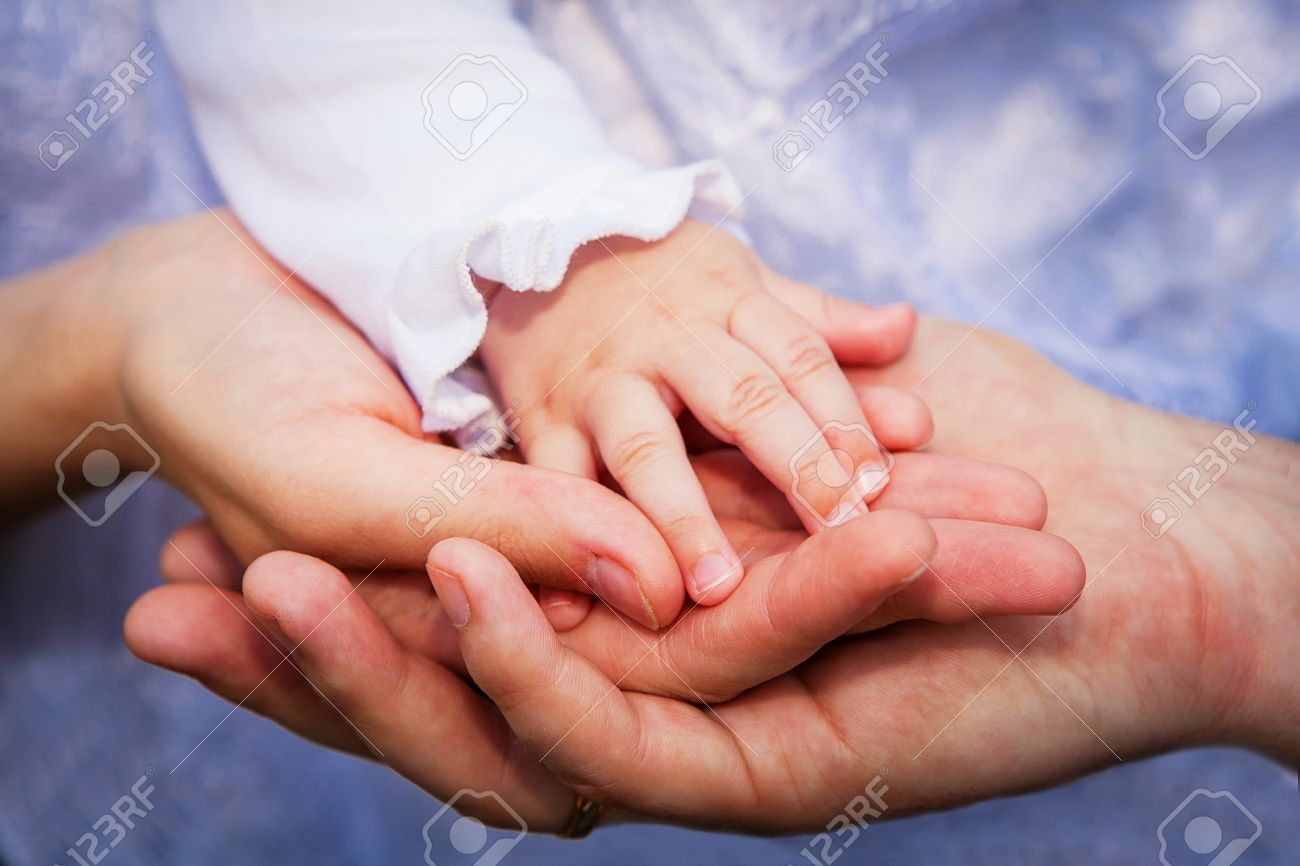 Father Mother And Baby Holding Hands Family Stock Photo Picture And