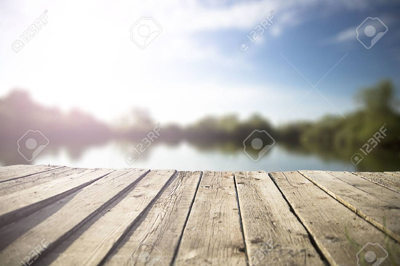 old wooden pier on the lake. - 48695379