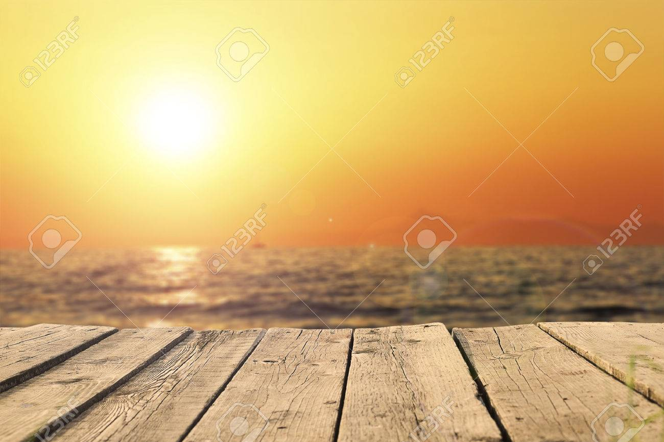 old wooden pier on the sea in sunset - 48695385