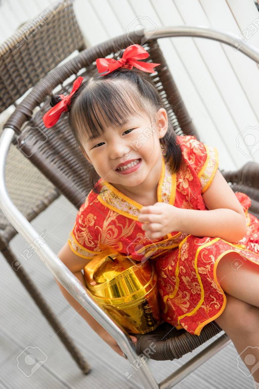 cabe51bd677d5 Cute Asian little girl wearing red traditional Chinese suit Stock Photo -  51786824