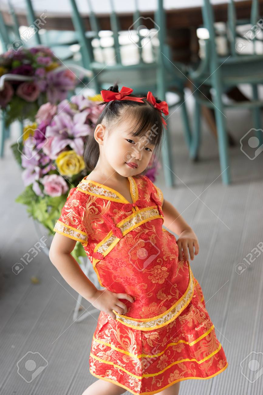 f6b5b69397ad8 Cute Asian little girl wearing red traditional Chinese suit Stock Photo -  51786827