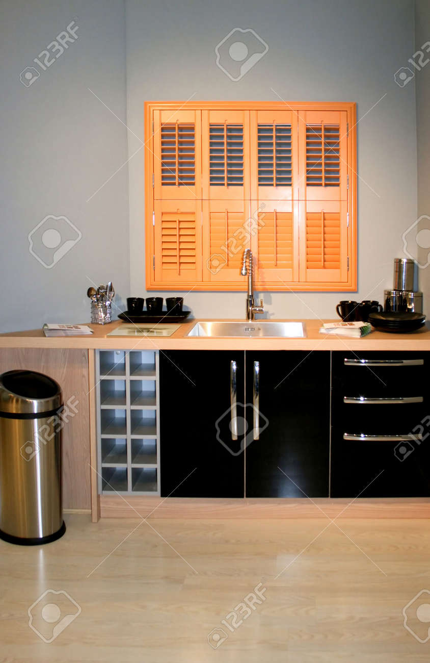 Modern Small Black Kitchen With Brown Window Stock Photo Picture