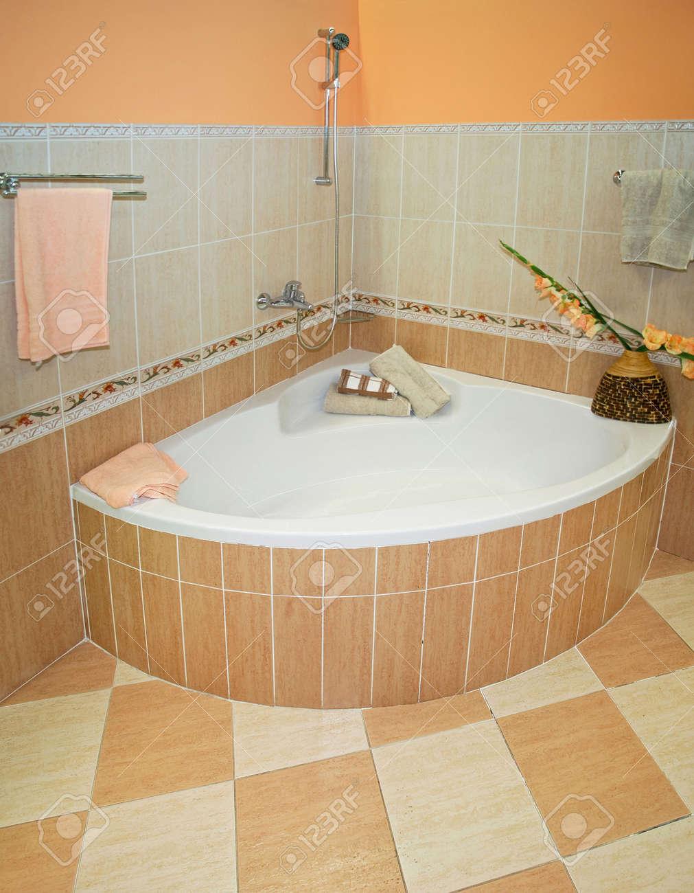 Bathroom with corner tub - Bathroom With Corner Bath Tub And Decorative Ceramics Stock Photo