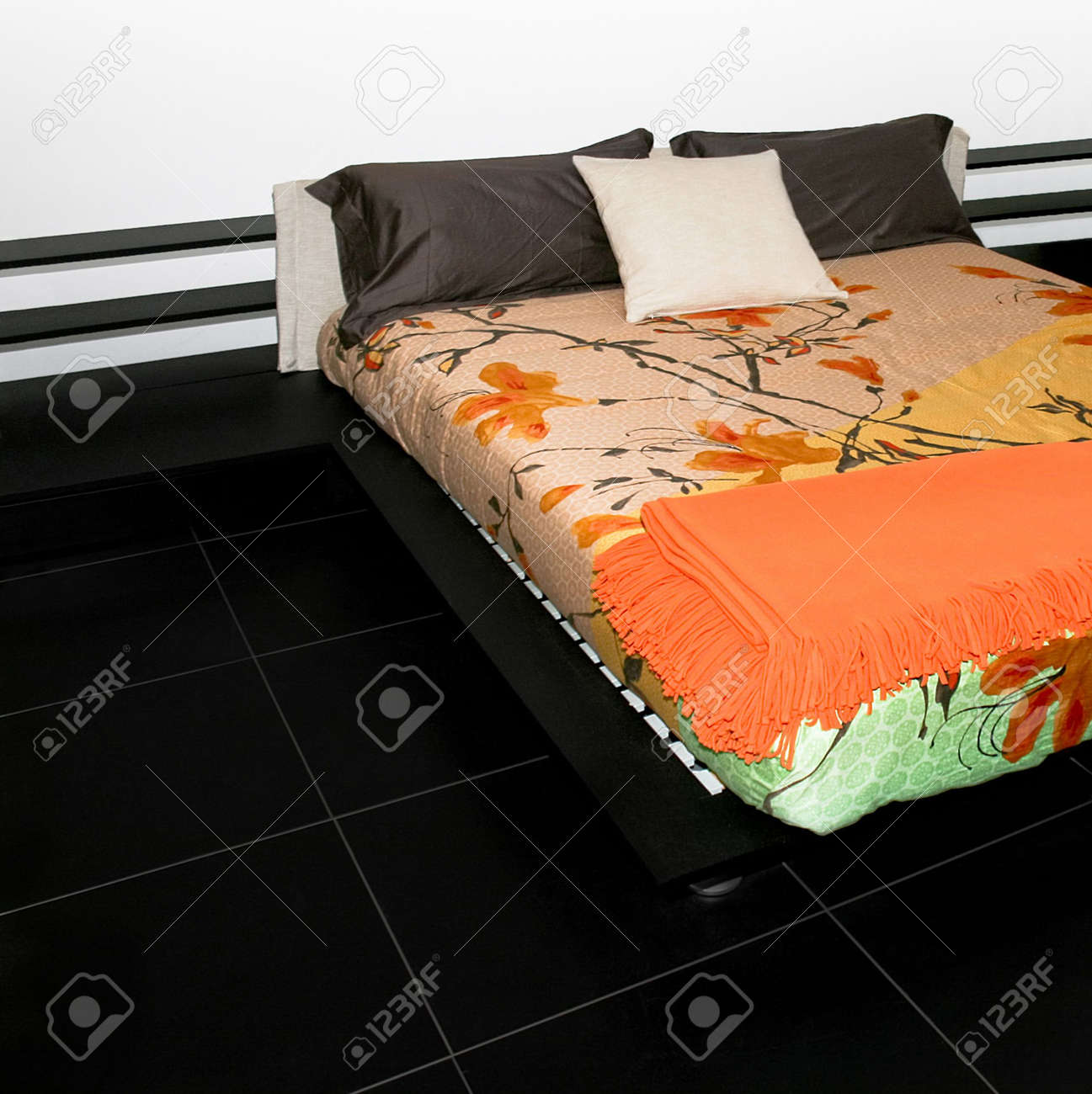 Bedroom with big double bed and colorful sheets Stock Photo - 2096239