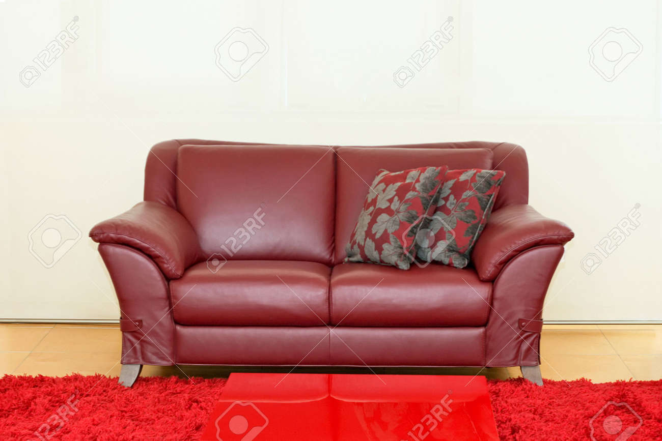 Dark red leather sofa over white wall Stock Photo - 2105549