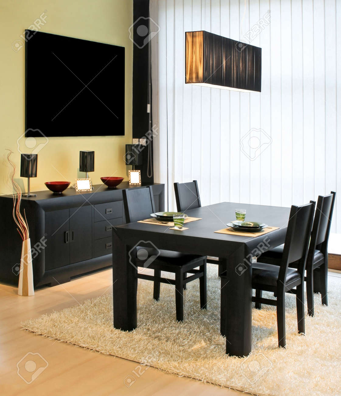 Modern dinning room with black table and closet Stock Photo - 2415984
