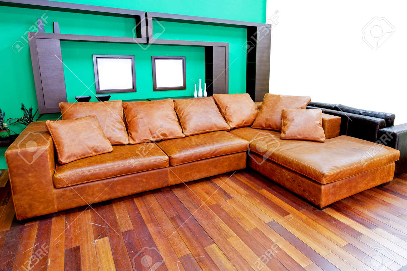 Living Room With Brown Leather Sofa Green Living Room With Brown Leather Sofa Stock Photo Picture And