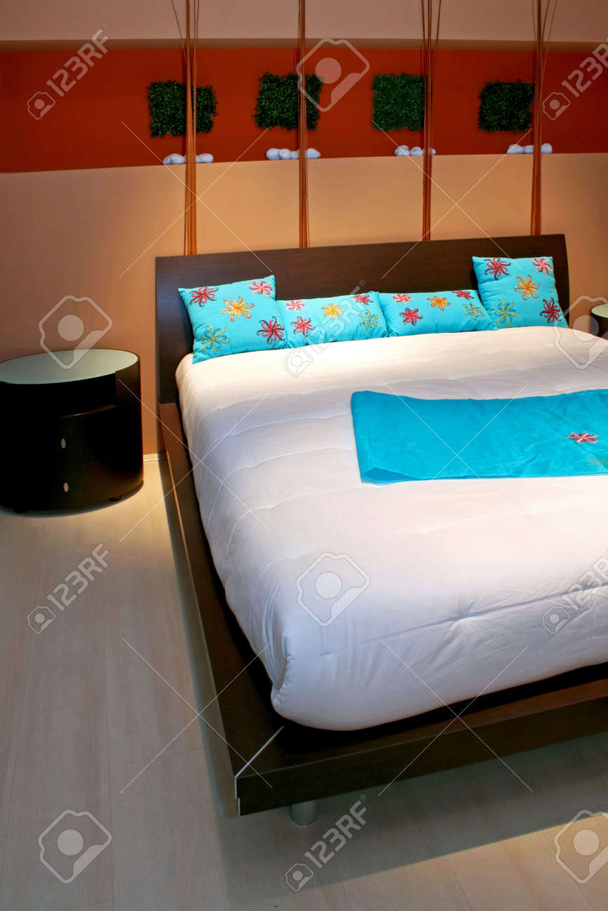 Modern bedroom with big bed and blue details Stock Photo - 3129215