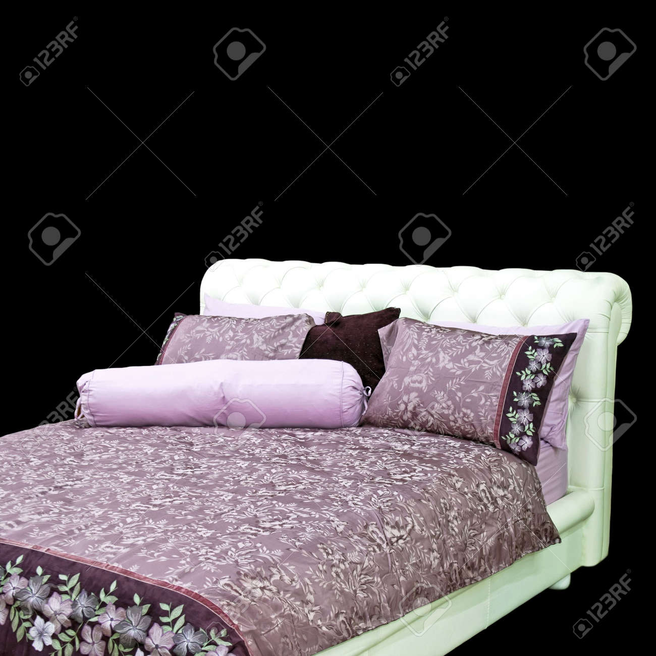 big double bed with purple bedding and pillows stock photo