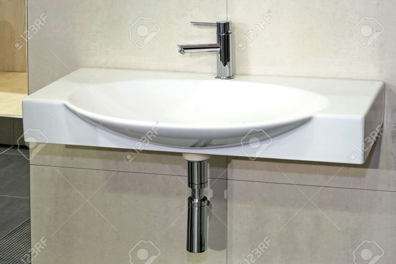 Simple white basin in wide oval shape Stock Photo - 3339388