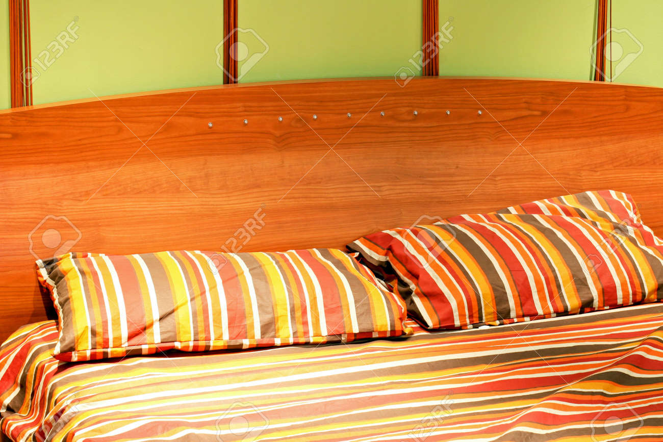 Bed with wooden frame and pillows with straps Stock Photo - 3606023