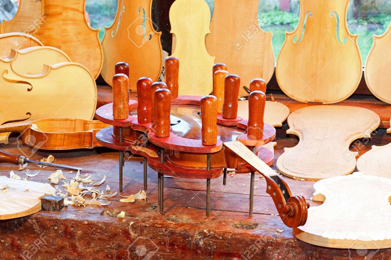 Close up shot of violin in press Stock Photo - 4835258