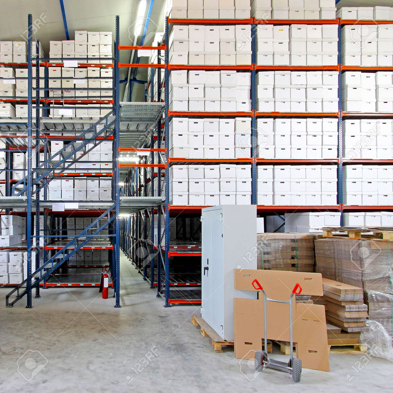 Safe box in front of big storage shelves Stock Photo - 5735538