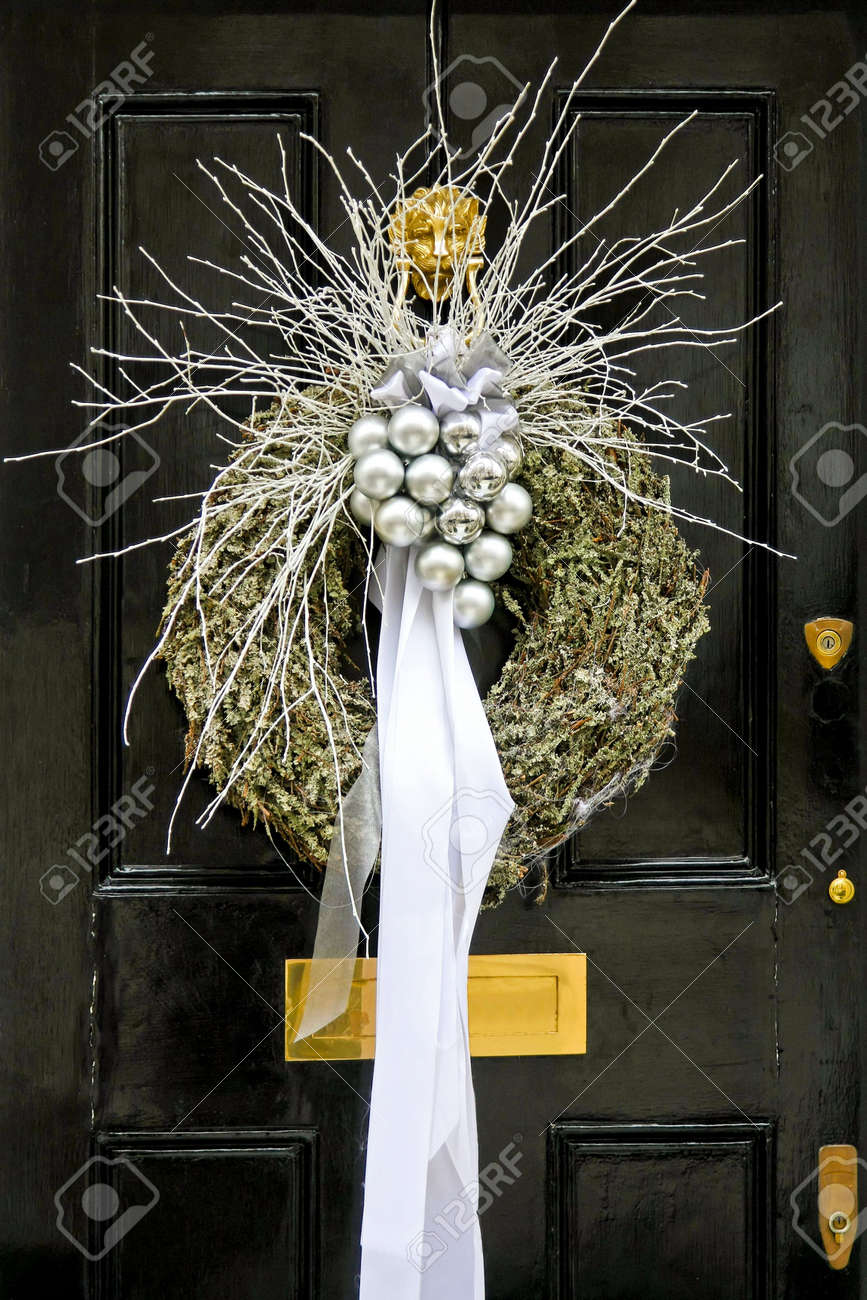 Christmas wreath with silver pendants at door Stock Photo - 5952707