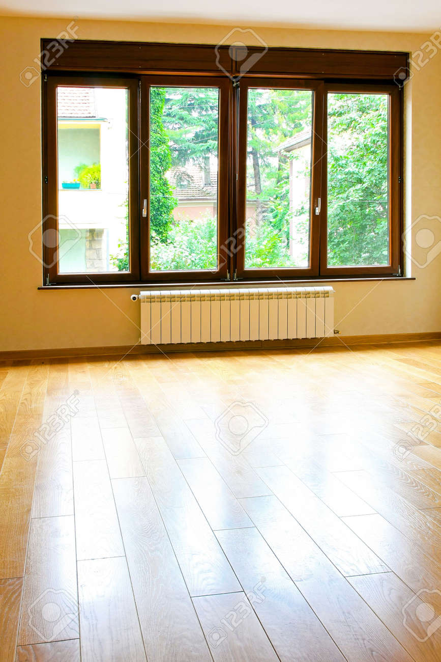 Big empty living room - Four Big Windows In Empty Living Room Stock Photo 6304290