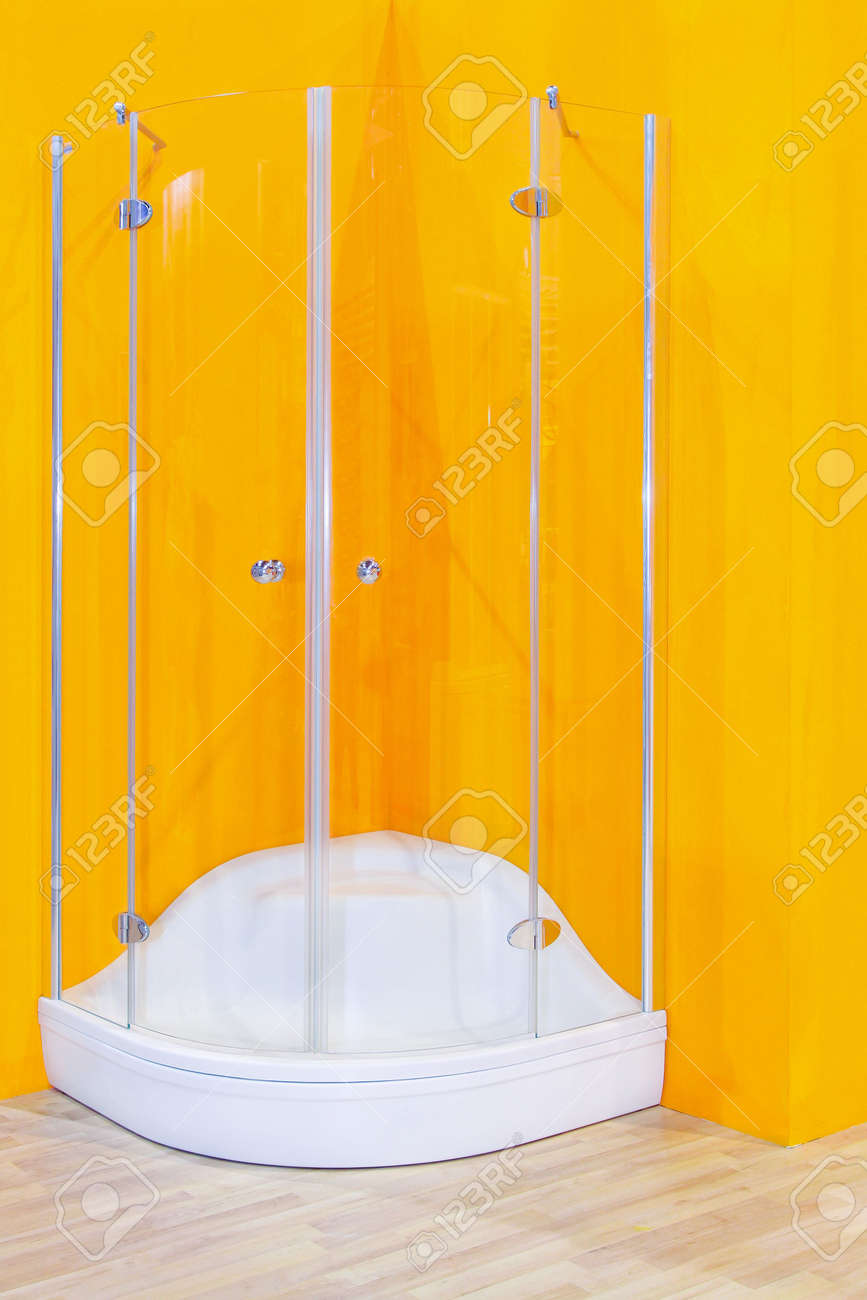 Corner Shower Cabin With Glass Wall And Yellow Background Stock ...