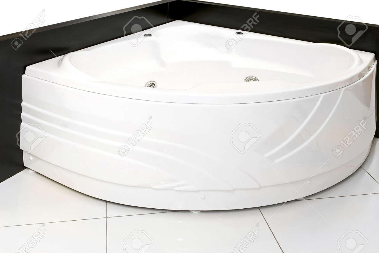 Big Bathtub With Hydro Massage In Bathroom Corner Stock Photo   7033481