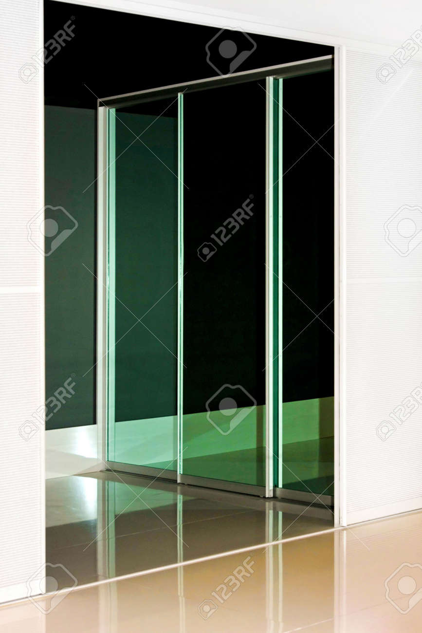 Mirrored Wardrobe Sliding Door With Reflection Of The Background