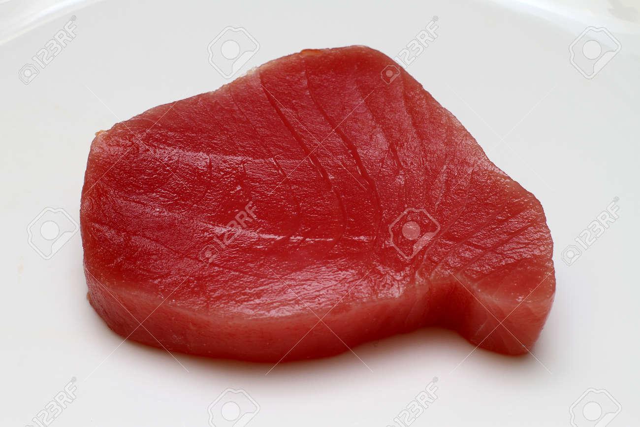 Fresh and raw tuna steak at plate Stock Photo - 10492110