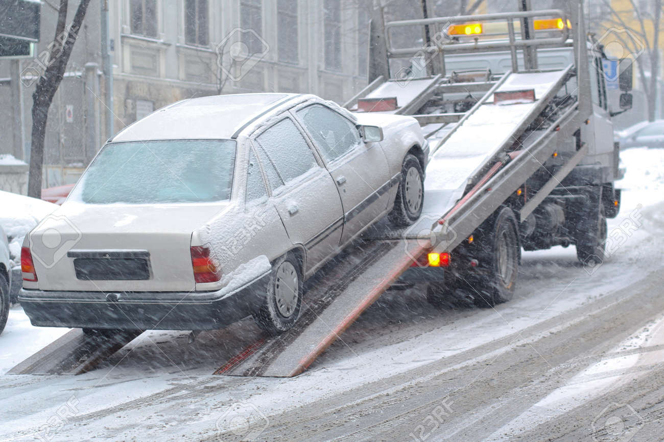 Car breakdown and towing assistance at snowy day Stock Photo - 10940427