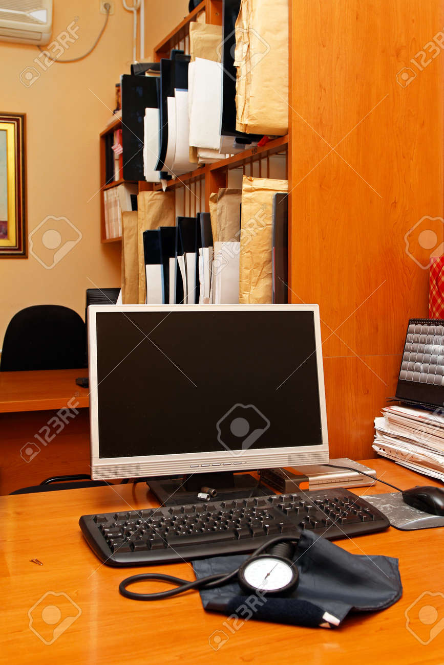 Doctors desk with blood pressure monitor Stock Photo - 12351361