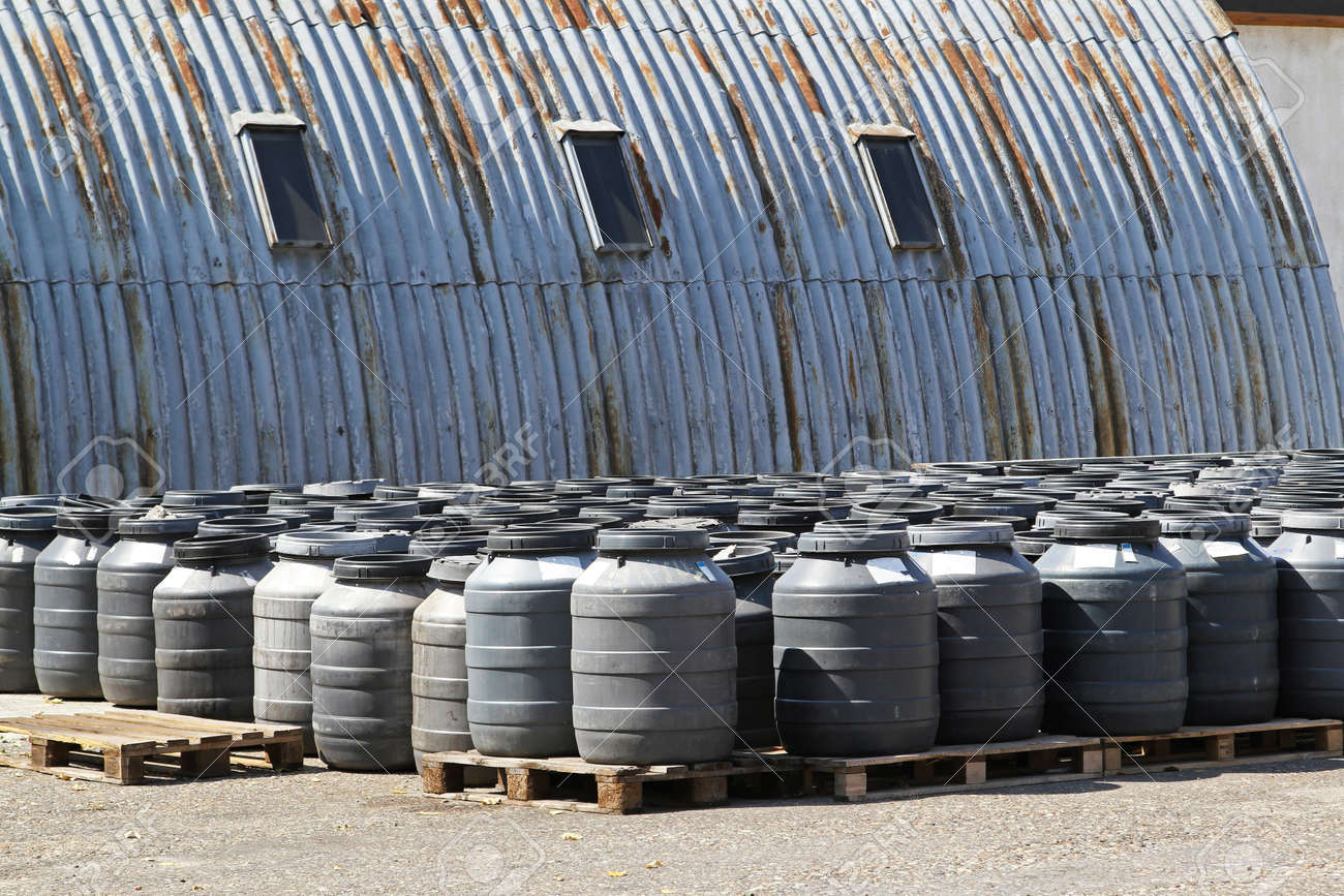 Chemical waste in plastic barrels near warehouse Stock Photo - 12351371