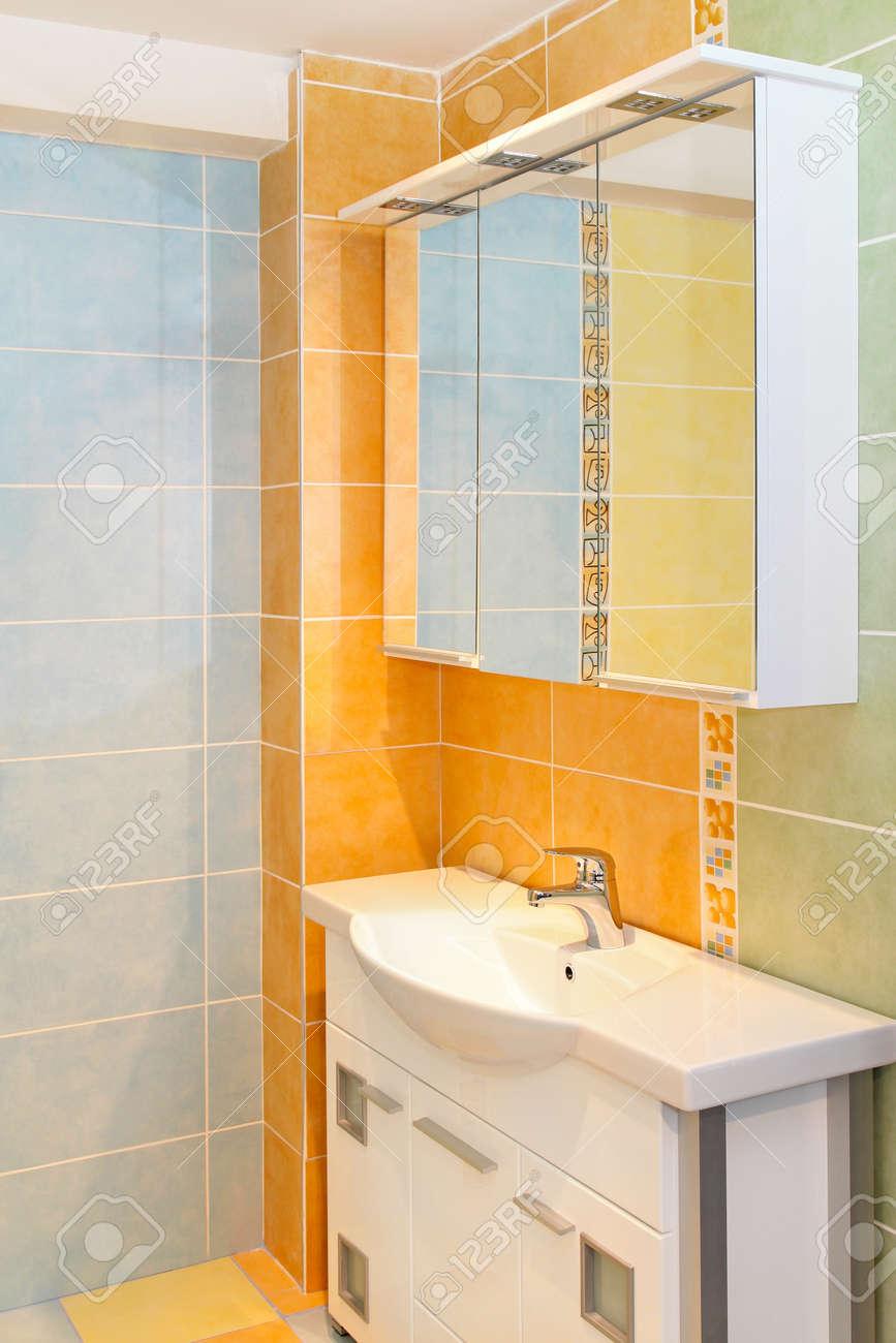 Small bathroom interior with modern orange tiles Stock Photo - 12880116