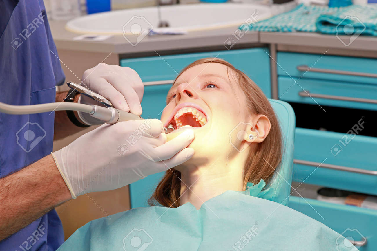 Young bloonde girl in dentist office chair Stock Photo - 14120883