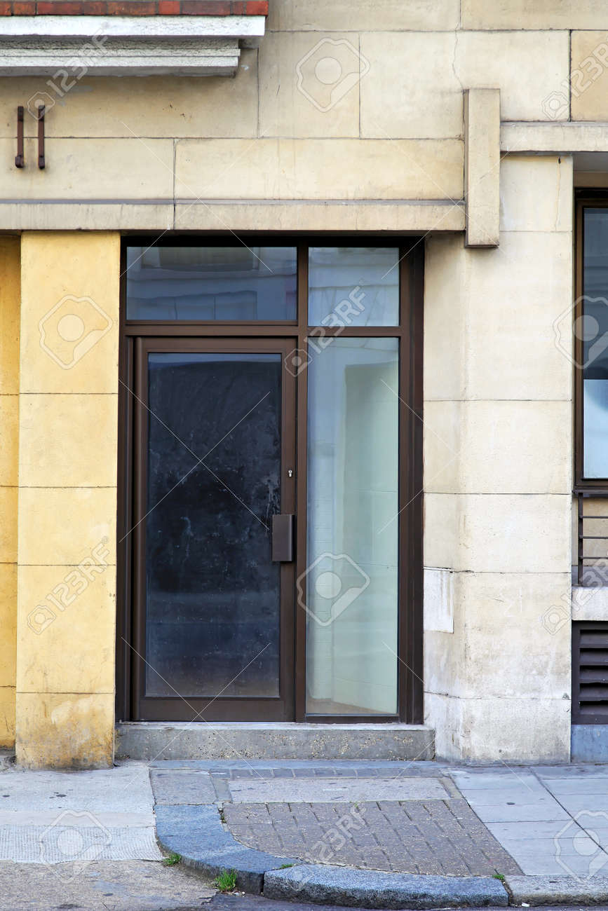 glass door entrance in old commercial building stock photo