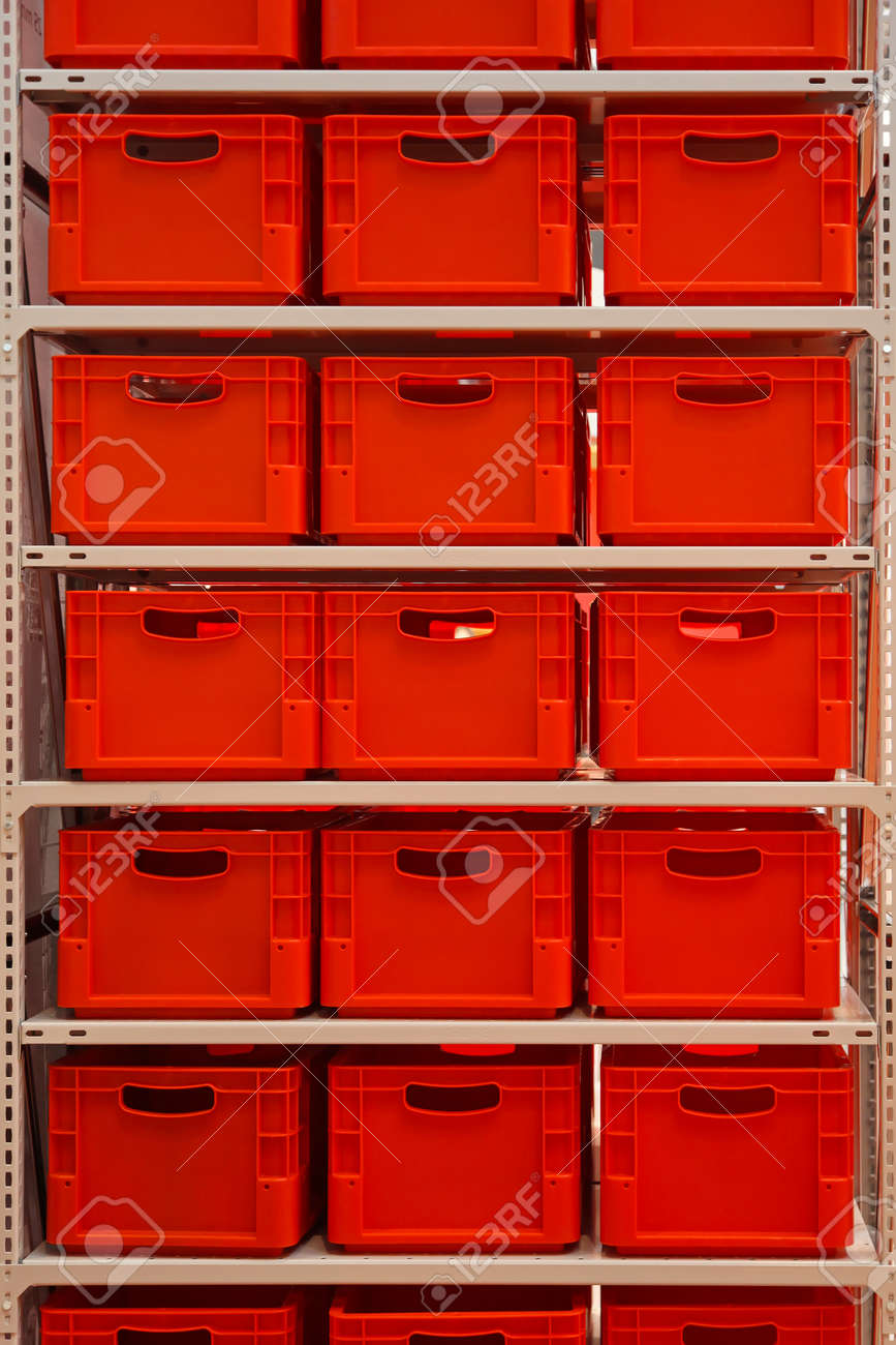 shelf with red plastic crates in warehouse stock photo picture and rh 123rf com