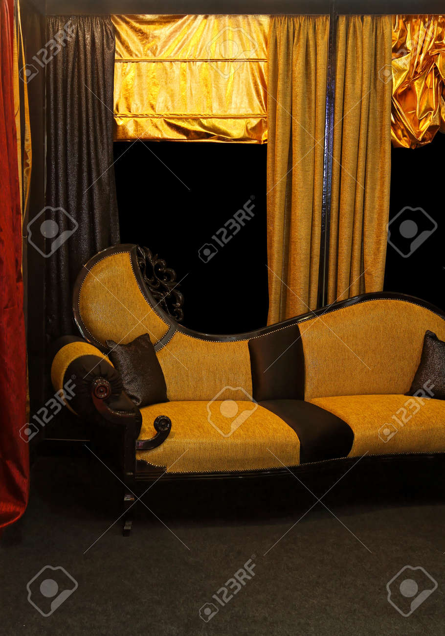 Old vintage sofa with carved wooden details Stock Photo - 15390872
