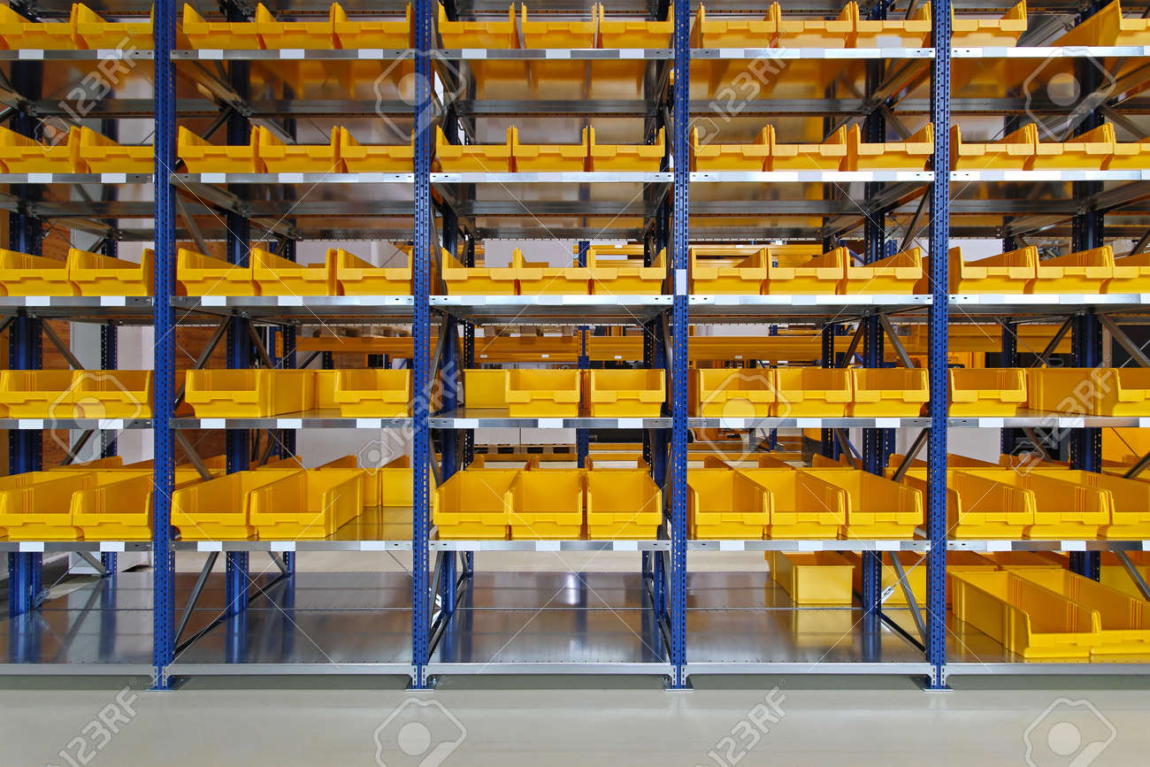 yellow plastic bin trays at shelf in warehouse stock photo picture